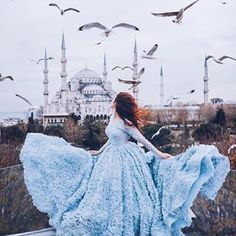 Save the post with this gorgeous location in Istanbul Can't feel more princess in this evening gown enjoying the view overlooking the Blue Mosque Does a perfect dress make every girl feel special?