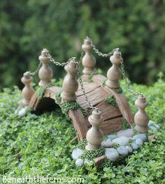 Miniature fairy garden bridge by beneath the ferns