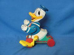 """1955 Fisher Price Walt Disney Donald Duck Pull Toy #765 – 8"""" T – Works   Art, Antiques & Collectibles Toys & Hobbies Vintage & Antique Toys   Auctions Online   Proxibid Antique Toys, Vintage Antiques, Duck Toy, Toys Online, Make Arrangements, Fisher Price, Donald Duck, Walt Disney, Hobbies"""