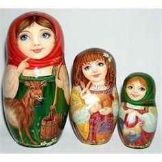 Lovely farm girls with barnyard animals stacking dolls.