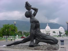 "statue of man with conch shell | Haitian Culture: ""Key people and symbols"""