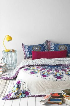 colorful bedding, perhaps a frame and headboard to elevate this look from half done/college dorm feel