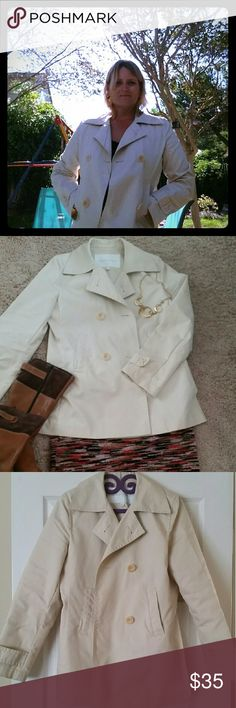 Banana Republic Trench ????Chic trench by Banana Republic, hip length, double breasted. Cotton twill, ivory color. Two small spots, about the size of a pencil point, see pic. Banana Republic Jackets & Coats Trench Coats