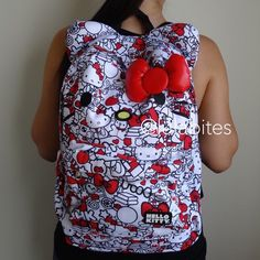 All over red Hello Kitty Backpack New Loungefly X Hello Kitty backpack. Comes with red 3D bow and 3D ears. Made of Nylon material. Sanrio Bags Backpacks