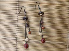 brincos rustico,envelhecido feito com corrente,sementes,coco e contas de madeira,base anzol.