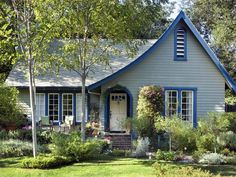 A cottage-style house typically refers to a small home made of stone or wood siding. It features a curved entryway, gravel or brick front walkway and brighter exterior colors. Today, flowers typically adorn the entryway creating beautiful curb appeal. Front Door Paint Colors, Exterior Paint Colors For House, Painted Front Doors, Paint Colors For Home, House Colors, Exterior Colors, Paint Colours, Exterior Design, Style At Home