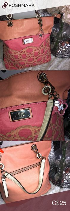 GUESS floral top handle purse Beautiful guess purse Top handle / shoulder purse Pockets inside and on the back of the bag Dangling guess logo charm Leather Salmon and orange in colour Guess Bags Shoulder Bags Guess Purses, Guess Bags, Closet Designs, Shoulder Purse, Online Clothing Stores, Floral Tops, Fashion Tips, Fashion Trends, Guess Handbags