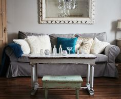 Love the grey slipcover/couch