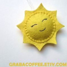 Smiling sun ornament from felt - I have some of these ready, but you can order it in any other color, please write me a mail about your custom order. Also you can have it as bunting, or toy. Size: the ornament itself is about 10 cm tall (4 inches) Perfect as a little gift for a friend,