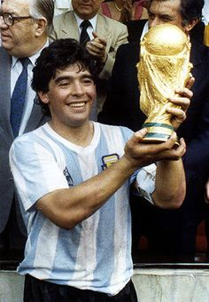 Diego Armando Maradona with the World Cup he strongly helped Argentina International futbol team win in 1986.