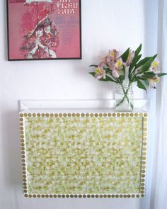 This cover gets pizzazz from a bit of decorative paper, which makes the AC unit blend seamless into this blogger's gallery wall. See more at Adventures Of a 40-Year-Old Intern »    - GoodHousekeeping.com Window Ac Cover, Window Ac Unit, Air Conditioner Cover Indoor, Diy Air Conditioner, Ac Unit Cover, Ac Units, Heating And Air Conditioning, Just In Case, The Unit