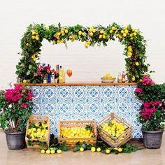 Lemon decor over bar. Photo: Jenny Haas, Floral: Molly Taylor & Co. Bridal Shower Decorations, Wedding Decorations, Italian Theme, Italian Party, Mediterranean Wedding, Capri, Event Themes, Summer Events, Green Wedding Shoes