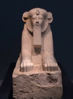 """Sphinx of Maatkare Hatshepsut -- This limestone and plaster piece depicts the female pharaoh Maatkare Hatshepsut as a sphinx . She has the body and mane of a lion, with the head of a human. Carved between the paws of the statue is a cartouche enclosing the pharaoh's throne name, """"Maatkare"""" (""""Truth is the Soul of the Sun.) (c. 1479-1458 BCE, the Metropolitan Museum of Art, New York)."""