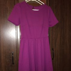 Super cute purple dress Dress only worn once, length above the knees, has a really cute cut out on the back with a button at the top, and the material is stretchy and very comfortable. The size is S-M. It will fit both sizes very well. Dresses