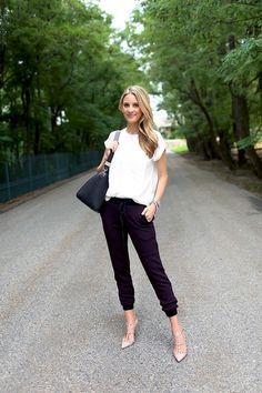 white top and track pants, structured bag, stylish shoes