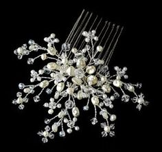 This elegant snowflake resemble bridal hair comb features a gorgeous ivory color scheme, with accents of Swarovski Crystals and Faux Pearls.This is the perfect accessory for a winter theme wedding celebration. This item is best worn on the side or back of a hairstyle.Size: Comb Measures 4-1/2 Wide x 3-3/4 Tall