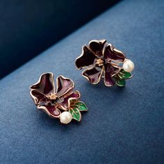 Beautiful Floral Enamel Stud Earrings for girls and women. Spring theme earrings studed with Pearls. High quality stud earrings. Pearl Stud Earrings. Gold plated earrings coated with professional enamel work. Enamel jewellery online. Pearl Stud Earrings, Gold Plated Earrings, Pearl Studs, Statement Earrings, Women's Earrings, Enamel Jewelry, Jewellery, Fashion Earrings Online, Spring Theme