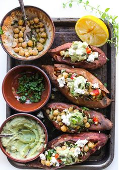 Mediterranean Stuffed Sweet Potatoes with Chickpeas & Avocado Tahini