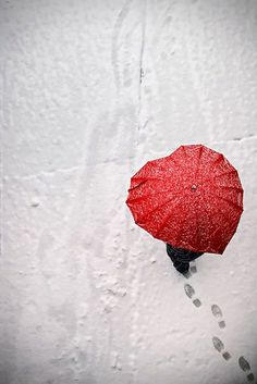 Red umbrella trudging through the snow ... heart shaped - ish ... artsy photography