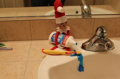 Elf helping out with the toothpaste