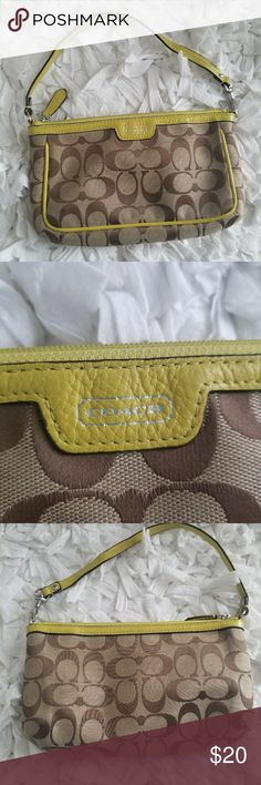 Coach wristlet wallet Super cute Coach wristlet. Classic Coach symbols on the front with some wear as seen in photos. Inside has slots for cards as well as as a larger slip pocket for cash. Please see the photos to show the slight stain on the inside of the larger slip pocket. Lots of life left in this wristlet!! Coach Bags Clutches & Wristlets