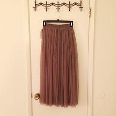 long mesh skirt khaki mesh maxi skirt. top to bottom 33 inch. elastic waist. fit from xs-m boutique Skirts Maxi