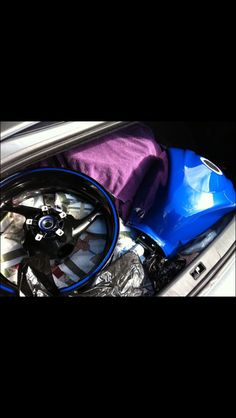 Naked girl at car body paint
