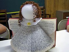 Hymnal angel instructions tell how to make one. You can add beads, lace, ribbon, facial features or other embellishments.