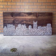 Now here's something the tool-averse can handle. Nashville–based Ashton E. Bemis uses simple ingredients, string and nails, to render everything from graphic letters to whole cityscapes.