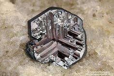 Hematite with Rutile - Cavradi gorge, Curnera Valley, Tujetsch (Tavetsch), Vorderrhein Valley, Grischun (Grisons; Graubünden), Switzerland Size: 5.95 mm