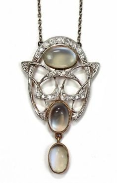 An Art Nouveau diamond and moonstone set pendant necklace designed by Archibald Knox for Liberty & Co.