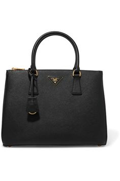 Black textured-leather (Calf) Open top Comes with dust bag Weighs approximately 3.3lbs/ 1.5kg Made in Italy