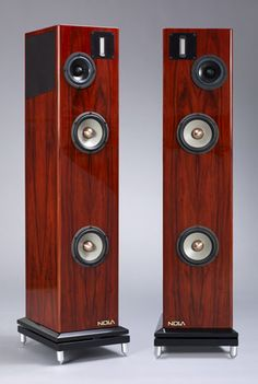Three-way, four-driver, floorstanding loudspeaker with vented enclosure. Drive-units: 63.5 by 10mmribbon tweeter; 100mm coated pulp-cone midrange unit; two 160mm magnesium-cone woofers with alnico magnets. Frequency range: 25Hz–100kHz. Sensitivity: 87dB/2.83V/m. Impedance: 8 ohms nominal, 4 ohms minimum. Dimensions: 1154mm H by 295mm W by 346mm D (all with plinth). Weight: 43.2kg.