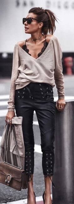 #spring #outfits woman wearing gray deep-v long-sleeved shirt carrying brown sling bag standing beside gray steel road baluster. Pic by @streetstyle_london
