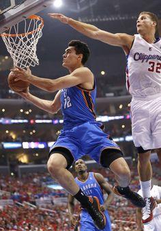 Oklahoma City s Steven Adams (12) goes to the basket as Los Angeles  Blake 849bb0c8e