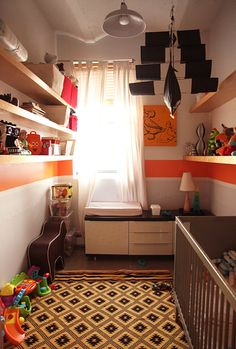 Room in a closet - great use of stripes and shelving