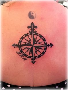 Compass tattoo on the back, fleur de lis compass tattoo