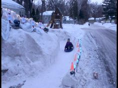 Dad Builds 12-Foot-Tall Homemade Ice Luge in Front Yard for His Kids