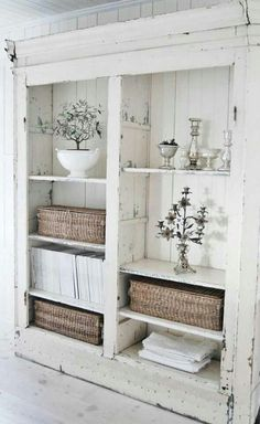 www.yournestdesign.blogspot.com What is it about chippy old white painted furniture that makes me drool? I think its the contrasts - something new with something time worn. I like the baskets - they add texture and a little warmth to this all-white presentation.