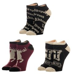 "The 3-pack of Harry Potter ankle socks features three different designs: a maroon pair featuring the Stag patronus and the 'Expecto Patronum"" spell, a black pair with a gold Hogwarts crest and geometrical design, and a black pair with gold metallic spells like 'Alohomora' and 'Stupefy'."