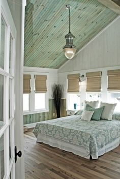 Simple beach deor in ths pastel green bedroom More