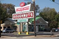 In 1933, Rudolph purchased a secret recipe for yeast-raised doughnuts from a New Orleans-French chef and opened a doughnut shop in Paducah, Kentucky. Rudolph soon moved to Winston-Salem, NC, (some say Camel cigarettes attracted him to the city) where he opened the first Krispy Kreme on July 13, 1937. From a rented building in what is now Historic Old Salem, Rudolph baked his Krispy Kreme doughnuts and sold them to local grocery stores. It was not long before the sweet smell of baking…