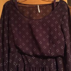 Free People burgundy flowy dress SZ L Free People SZ L. Burgundy patterned dress. The outer layer of the dress is sheer. It comes with a separate slip for underneath. Machine wash. This dress is in good pre worn condition. No snags, pulls, stains, etc.  This dress is amazing because it can be worn throughout the year. With sandals, heels or tights and boots. Free People Dresses