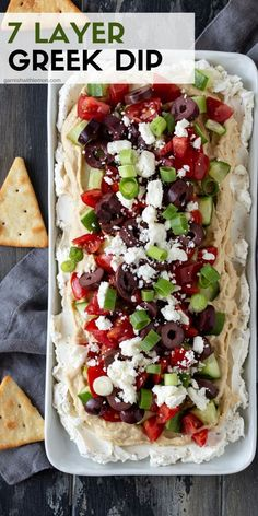 This Layered Greek Dip recipe (a spinoff of a dip) is an easy, make-ahead appetizer for a party. The briny Kalamata olives, juicy cucumbers, salty feta and garlicky hummus remind me of my favorite Greek salad. appetizers for a party Layered Greek Dip Greek Layer Dip, Greek Dip, Greek Salad, Greek Hummus Dip, Feta Dip, Fingerfood Recipes, Yummy Appetizers, Vegetarian Appetizers, Easy Appetizers For Party