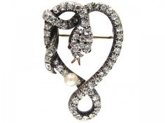 A wonderful lover's brooch – this piece has all the hidden meanings. The entwined snake is designed in a heart shape and represents 'Eternal Love'. The pearlsymbolises wisdom through experience and is believed to attract wealth and luck as well as to offer protection.As well as symbolising love, excellence and purity the diamonds, because of …