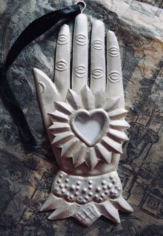 Heart and hand milagro - I have this and love it - I want it as a cookie cutter! Memento Mori, Hand Kunst, Talk To The Hand, Show Of Hands, Heart Hands, I Love Heart, Arte Popular, Hand Art, Mexican Folk Art