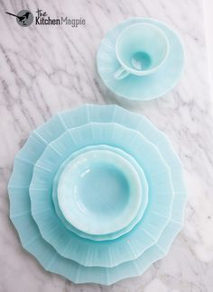 These Pyrex Pastel Blue Berry Bowls, Cups, Saucers, Plates are all made in Canada only and are a completely different blue than the other delphites, closer to a Robin's egg blue.
