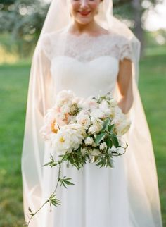 Look at the shape of that bouquet.  Amy Merrick. black-tie-manhattan-wedding-garden-rose-peony-bouquet