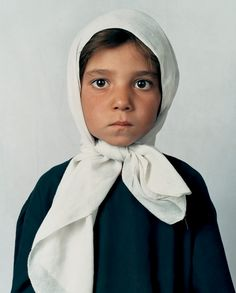 """Seven year old Arzo, The Ashuqan School """"The Taliban was the enemy of education, particularly for women. I am trying to bring the pupils from the darkness to the light."""" - Khaliq Dad, 42, principal of the Ashuqan School, Kabul, Afghanistan Photo by James Mollison"""