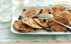 These whole wheat pancakes are studded with warm blueberries and make a healthy morning treat. Freeze pancakes in stacks of three for breakfast later in the week.